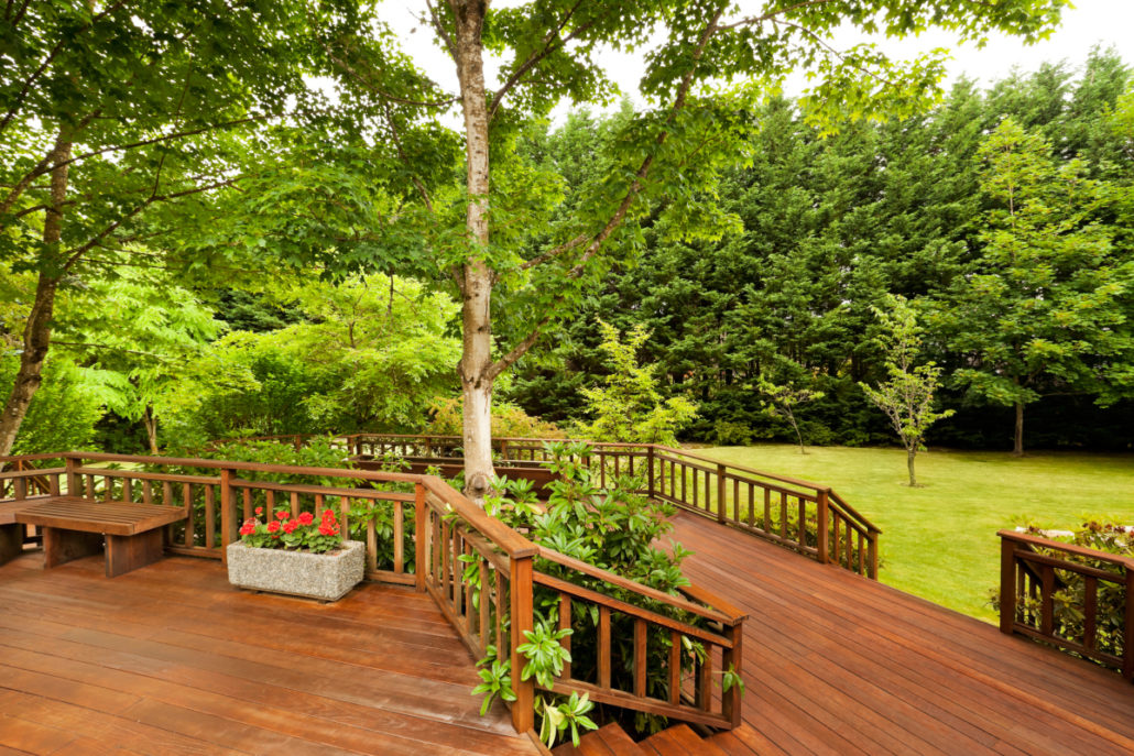 large deck in the back of a house after a home renovation